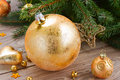 Golden christmas ball decoration with evergreen tree Stock Photo