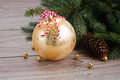 Golden christmas ball decoration with fir tree Royalty Free Stock Photography