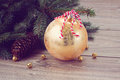 Golden christmas ball decoration with fir tree retro toned Royalty Free Stock Images
