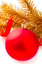 Golden christmas ball on fir tree branch Royalty Free Stock Images