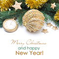 Golden christmas ball and spruce branches selective focus on white Royalty Free Stock Images