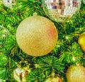 Golden Christmas ball on Christmas tree Royalty Free Stock Photo