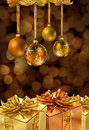 Golden Christmas balls and presents Stock Photos