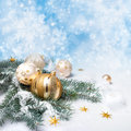 Golden christmas decorations on abstract winter background Stock Images