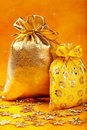 Golden christmas gift sacks and golden snowflake Royalty Free Stock Images