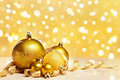 Golden Christmas ornaments with blur light Royalty Free Stock Photo