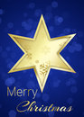 Golden christmas star on blue bokeh background a with snowflakes a with merry greeting Stock Photo