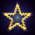 Golden Christmas star with spiral in blue Stock Photos