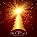 Golden Christmas tree background with starburst Royalty Free Stock Photo