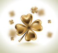 Golden clover leaf, vector illustration for St. Patrick day. Blured four-leaf on light white background