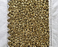 Golden coffee beans and white tablecloth border frame with lacy edge Stock Photo