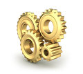 Golden cog gears Stock Photography
