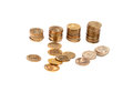 Golden coins in piles with scattered isolated over white background Royalty Free Stock Images