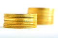 Golden coins stacks two small gold isolated on white background concept photo of bank money banking finance economy saving and Stock Image
