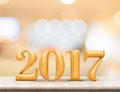 Golden color 2017(3d rendering) new year on marble table top wit Royalty Free Stock Photo