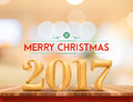 Golden color 2017 Merry christmas (3d rendering) on brown wood t