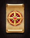Golden compass rose & vintage scroll map Royalty Free Stock Photo