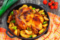 Golden crispy skin chicken grilled in oven with potato wedges