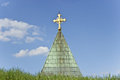 Golden cross on church over blue sky Stock Photography