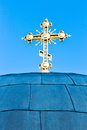 Golden cross on church over blue sky. Kiev, Ukraine. Royalty Free Stock Photo