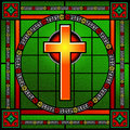 Golden cross stained glass window with decorative borders Royalty Free Stock Photography