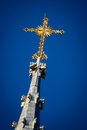 Golden Crucifix Atop Church Steeple Royalty Free Stock Images