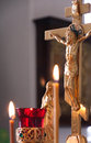 Golden crucifix religious christian image in a russian orthodox church with decorations and candles in front of it Stock Photos
