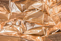 Golden crumpled foil texture Royalty Free Stock Photo