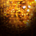 Golden crystal bokeh christmas abstract background glitter Stock Photography