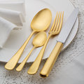 Golden cutlery on white plate Stock Images