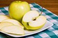Golden Delicious apple sliced on a plate Royalty Free Stock Images