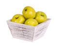 Golden delicious apples in wooden container Royalty Free Stock Photography
