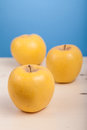 Golden delicious fresh ripe apples in a studio setting Royalty Free Stock Photography