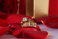 Golden diamond ring with gift box and red rose on with satin background Stock Photography
