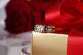 Golden diamond ring with gift box and red rose on with satin background Royalty Free Stock Images