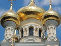 The golden dome of the cathedral yalta crimea domes against blue sky Stock Image