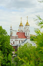 Golden dome of the church in the distance against the sky Royalty Free Stock Photo