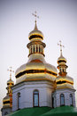 Golden domes of kiev pechersk lavra in the evening Royalty Free Stock Images
