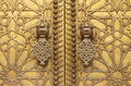 Golden door knockers the of the royal palace in fes morocco Royalty Free Stock Images