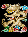Golden dragon with colorful clouds black backgroun flying through Royalty Free Stock Photos