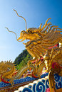 A golden dragon statue Stock Images