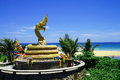 Golden dragon statue on karon beach phuket thailand Stock Photography