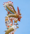 Golden dragon wrap wood pillar Royalty Free Stock Photo