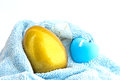 Golden easter egg candle blue towel Stock Image