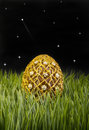 Golden easter egg with stars in background Royalty Free Stock Images