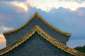 Golden eaves the close up of of buddhist temple in sunset glow Royalty Free Stock Images