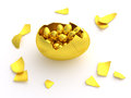 Golden egg crack opened with eggs isolated gold cracked and hatched full of smaller inside theme for easter hunting fun or Royalty Free Stock Images