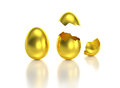 Golden egg with one crack opened isolated gold eggs normal and cracked and hatched the top part at two different angles theme for Stock Photography