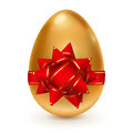 Golden egg with red bow realistic tied a ribbon stripes and a Royalty Free Stock Images