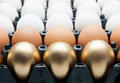 Golden eggs duck eggs and chicken eggs in package Royalty Free Stock Photo
